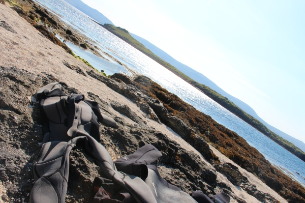 Wetsuits on beach